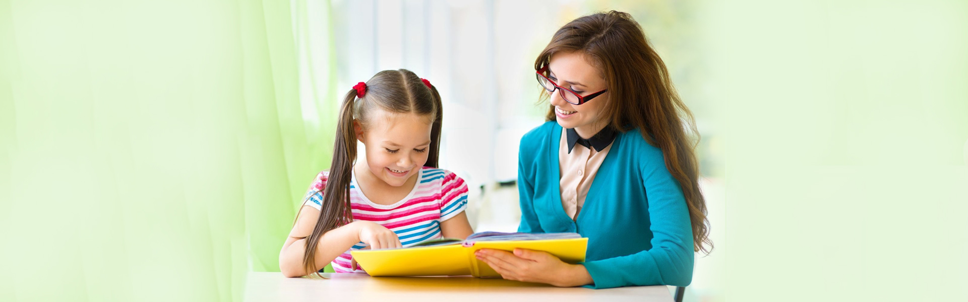 Teacher help in studying to a small girl